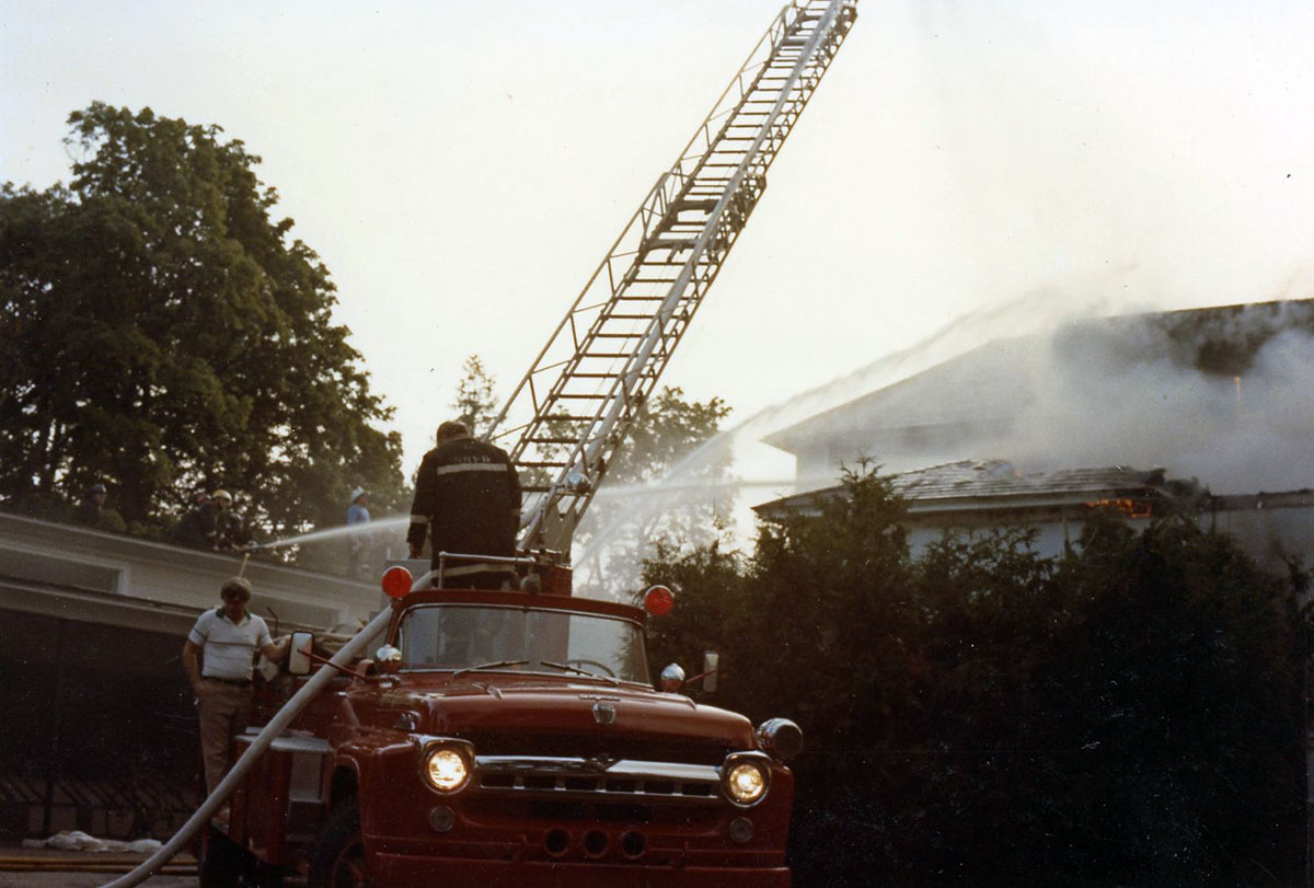 Firetruck Responding to Kaelber Hall Fire, photograph, July 1983