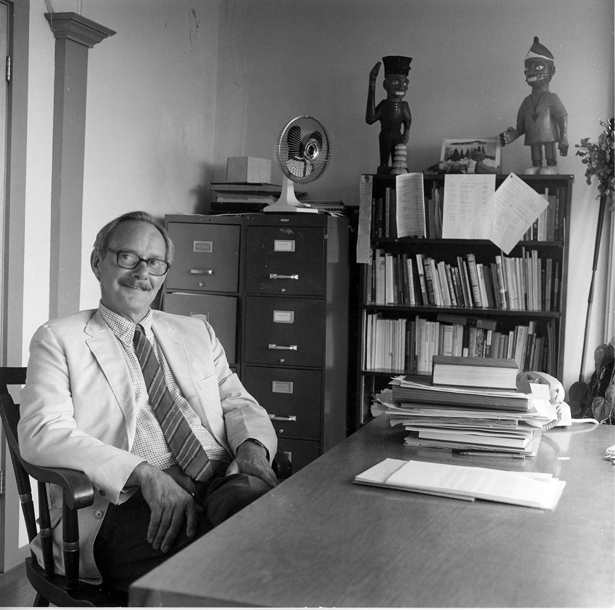 Ed Kaelber seated at desk, photograph